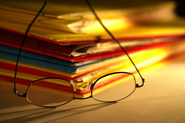 A stack of files with spectacles