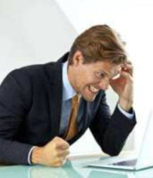 Man holding his head and looks very stressed