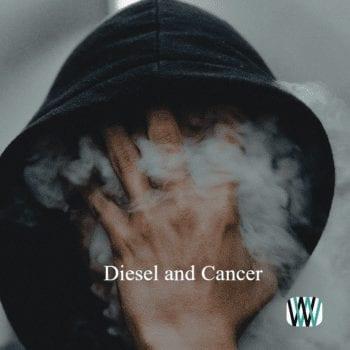Hooded man breathing diesel smoke